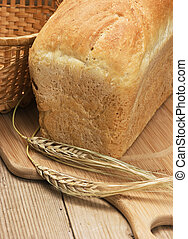 wheat bread on a wooden table
