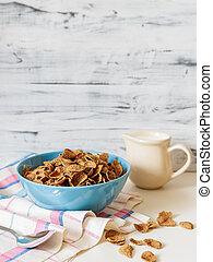 Wheat buckwheat bran breakfast cereal with milk in ceramic bowl
