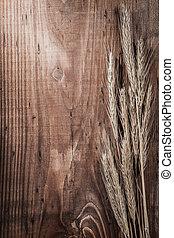 wheat ears on vintage wood board