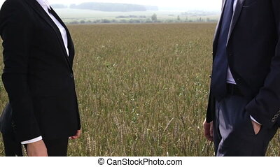 Wheat-field partnership - Business people shaking hands...