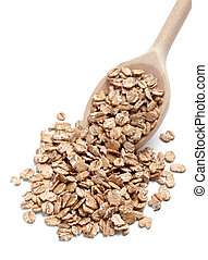 close up of wheat flakes in wooden spoon on white background with clipping path