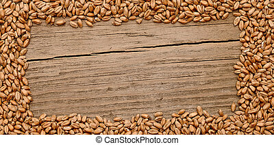 wheat frame on the wood background