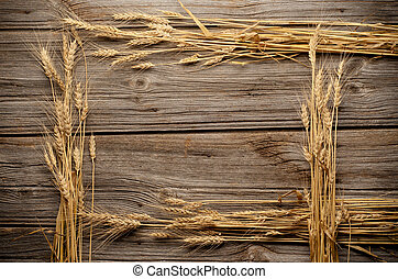 Wheat frame on wooden with copy space.