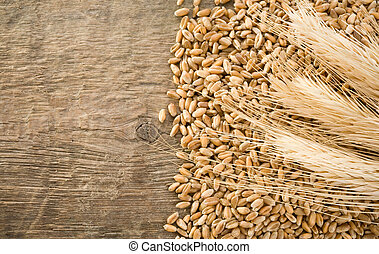wheat grain and ear on wood texture background