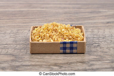 Wheat groat on wood