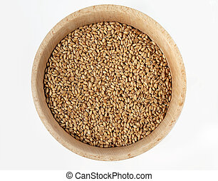 Wheat in wooden bowl