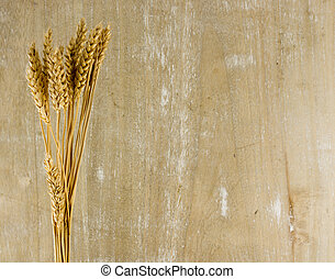 wheat plants on wooden background - wheat plants with wooden...