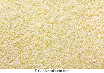 Wheat semolina (farina) close-up. Full frame, top view.
