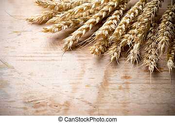 Wheat. - Wheat bunch with a menu board, wooden background.