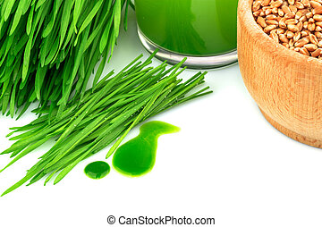 Macro view of wheatgrass juice with sprouted wheat, wheat in wooden bowl isolated on white background