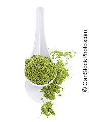Wheatgrass. - Wheatgrass powder on white spoon isolated on...