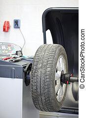 Wheel balancing machine.Focus on the wheel