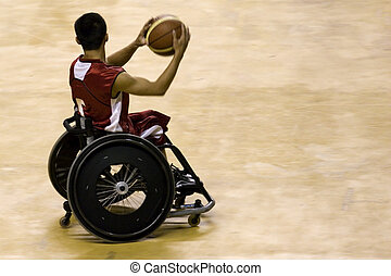 Wheel chair basketball player in action in an international tournament.