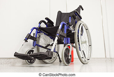 Wheel chair in hospital corridor