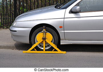 Wheel Clamp - Car with wheel clamp found somewhere