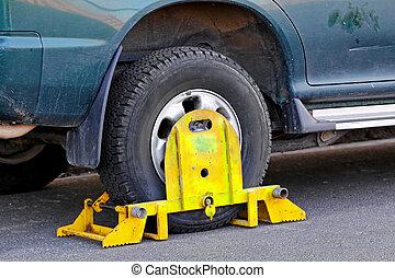 Wheel clamp - Unauthorized park vehicle with yellow wheel...