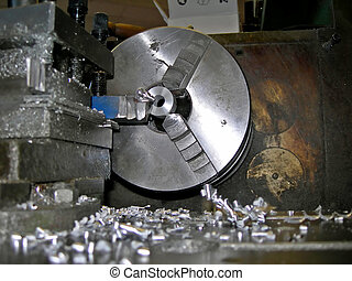 wheel lathe -  Detail of lathe processing a metal bar
