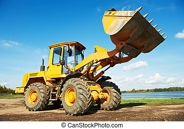 wheel loader excavator at work - heavy wheel loader ...