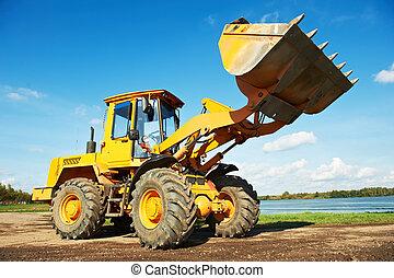 wheel loader excavator at work - heavy wheel loader ...