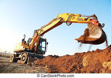 wheel loader excavator machine loading doing earthmoving work at sand quarry