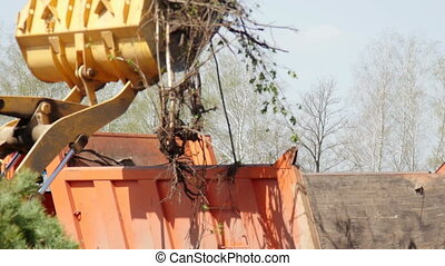 Wheel loader excavator removing construction garbage
