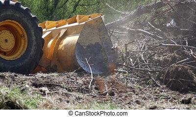 Wheel loader excavator removing construction garbage. 4K...