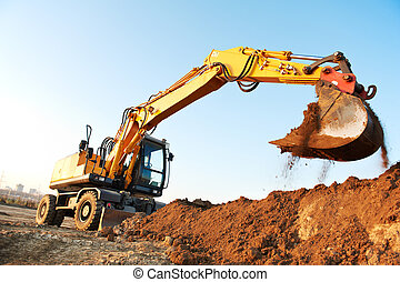 wheel loader excavator machine loading doing earthmoving...