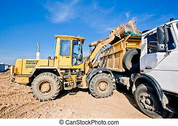 Wheel loader loading dumper truck