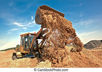 Wheel loader unloading soil