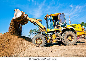 Wheel loader unloading soil - Wheel loader machine unloading...