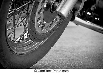 Wheel motorcycle close up.