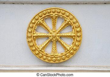 Wheel of law, Dharma on the wall.