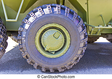 Wheel of military transport - Wheel of military machine at...