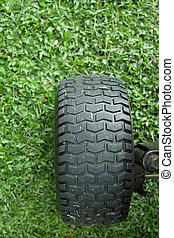Wheel on the green grass