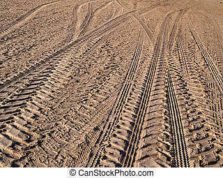 Wheel tracks on country road sand