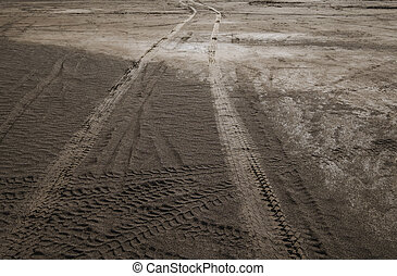 Wheel tracks on dirt road
