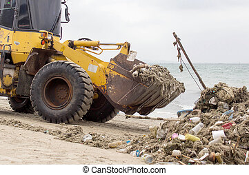 Wheel tractor cleaning with clean up Garbage on the seashore  on trails