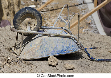 Wheelbarrow at building site - Rotated wheelbarrow standing...