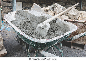 wheelbarrow filled with cement on a renovation project