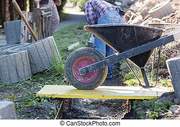 wheelbarrow full with concrete
