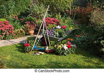 Wheelbarrow, grass mower, garden equipment, preparing for...