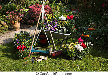 Wheelbarrow, grass mower, garden equipment