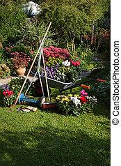 Wheelbarrow, grass mower, garden equipment