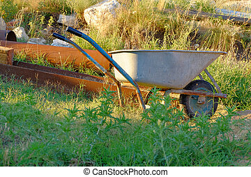 Wheelbarrow on backyard.