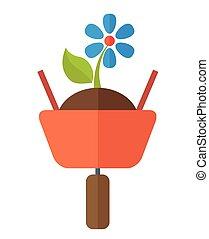 Wheelbarrow with plant - A wheelbarrow with soil and flower...