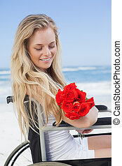 Wheelchair bound blonde smiling on