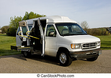 handicap van with a wheelchair lift in the up position