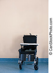 Wheelchair near wall in home for the elderly