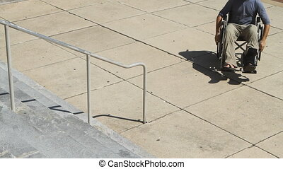 Wheelchair No Ramp Frustration - Man in a wheelchair rolls...
