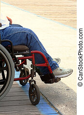 Wheelchair On Boards - Man in wheelchair on side of...